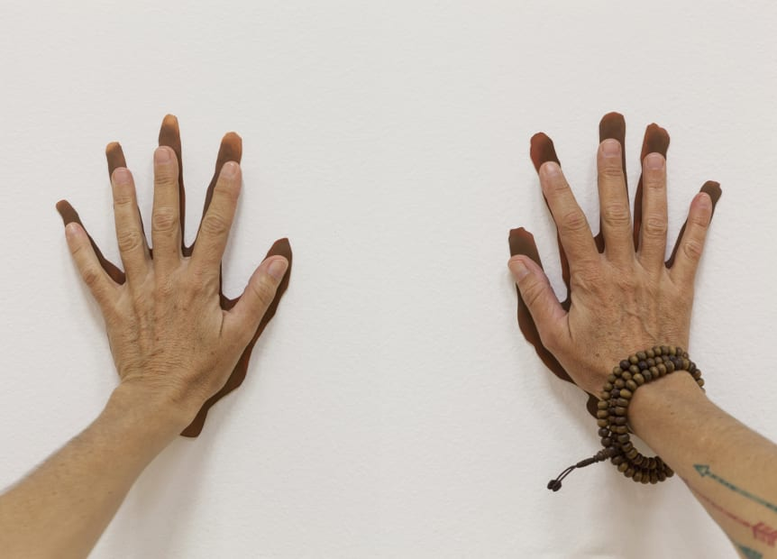 hands touching wall