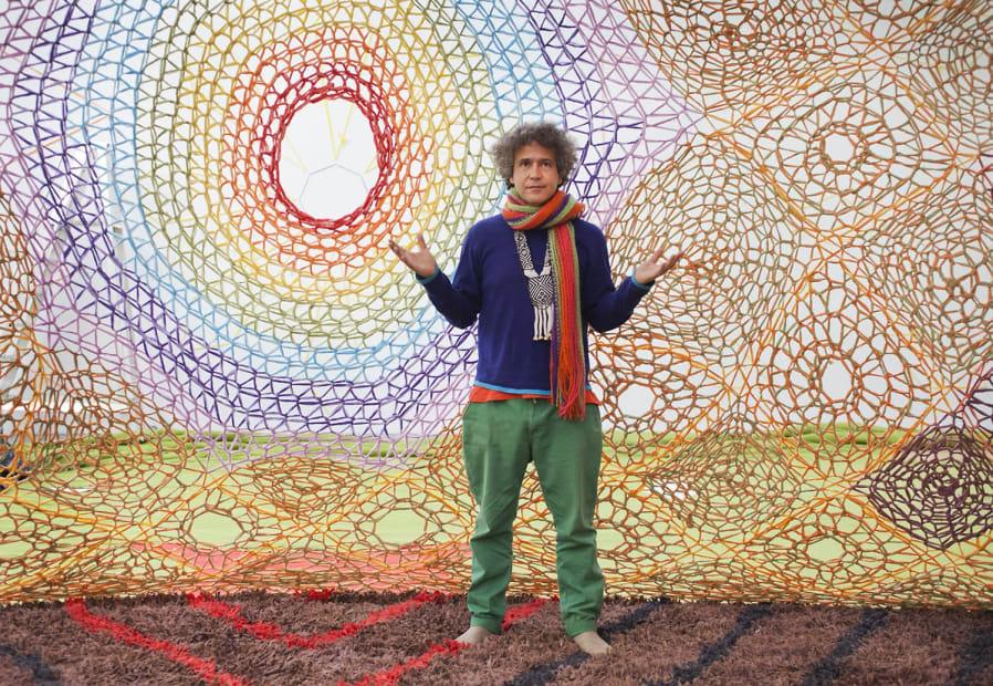 Ernesto inside the Ernesto Neto crochet installation