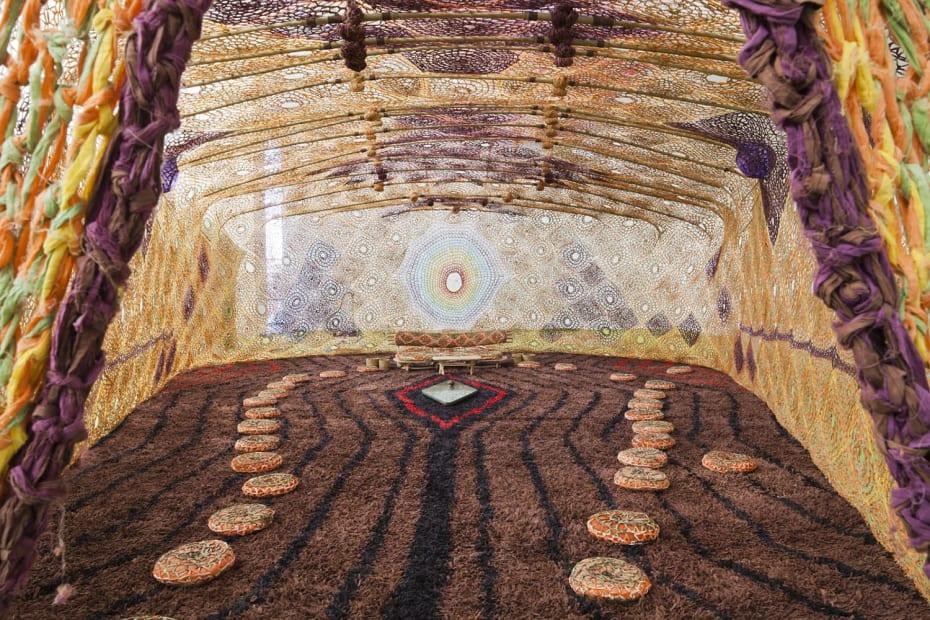 inside Ernesto Neto crochet installation