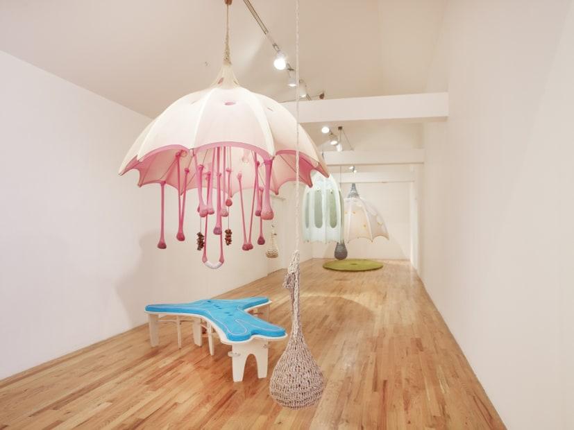 Ernesto Neto installation at the Aspen Art Museum, umbrella with a bed