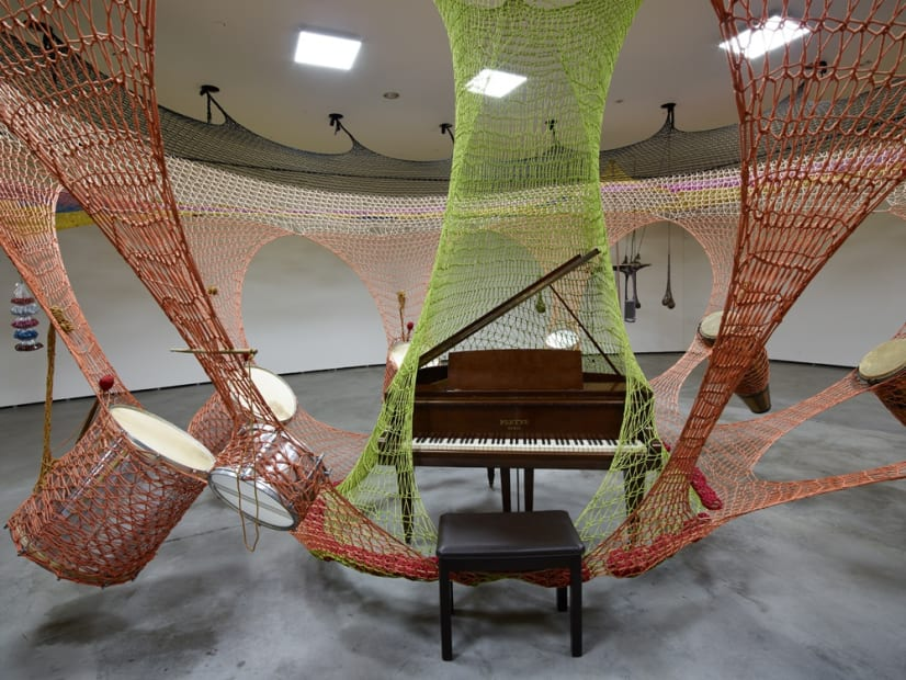 Crochet ceiling installation with instruments