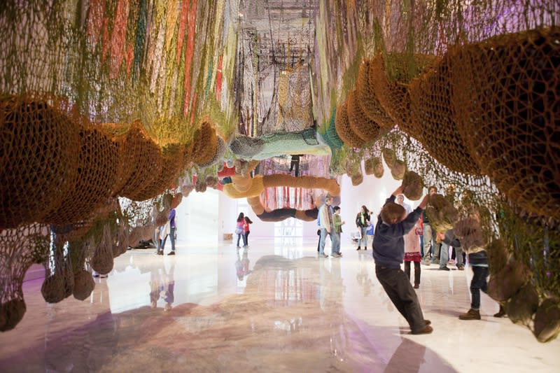 Ernesto Neto crochet hanging installation, walkway for visitors with people