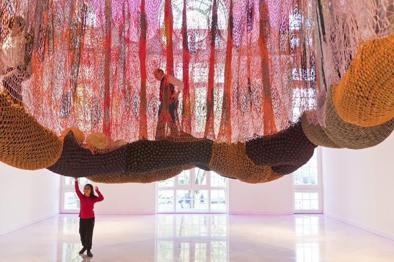 Ernesto Neto crochet hanging installation, walkway for visitors wiht people