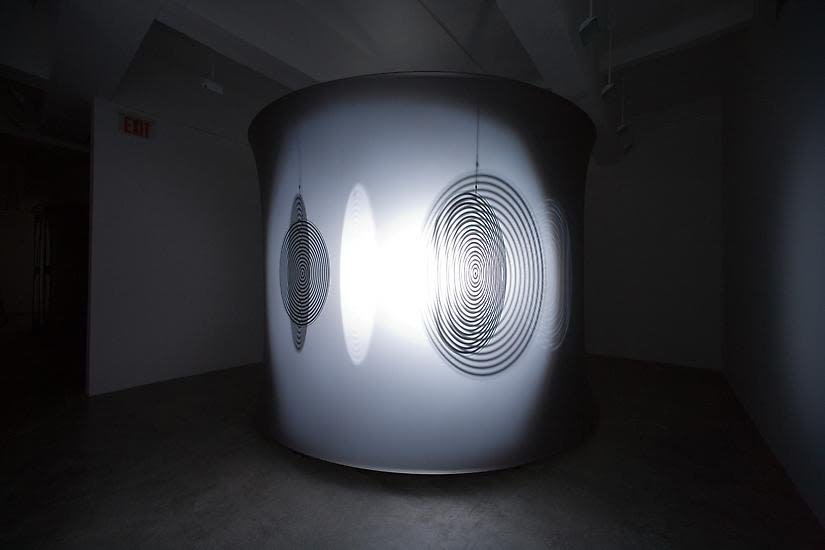 Eliasson dark room with shadows turning disc