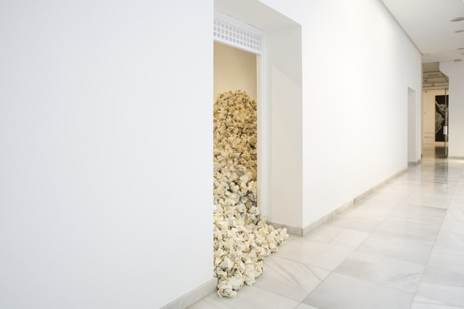 entrance to room filled with paper