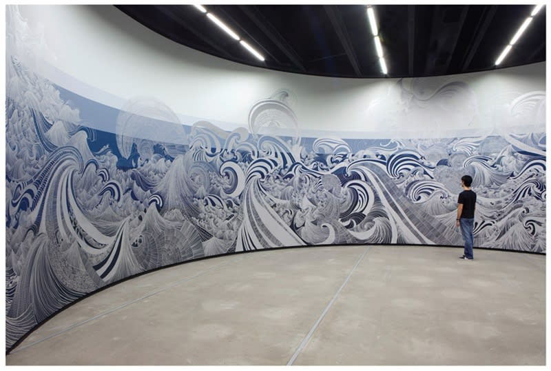 painting installation of waves in circular room