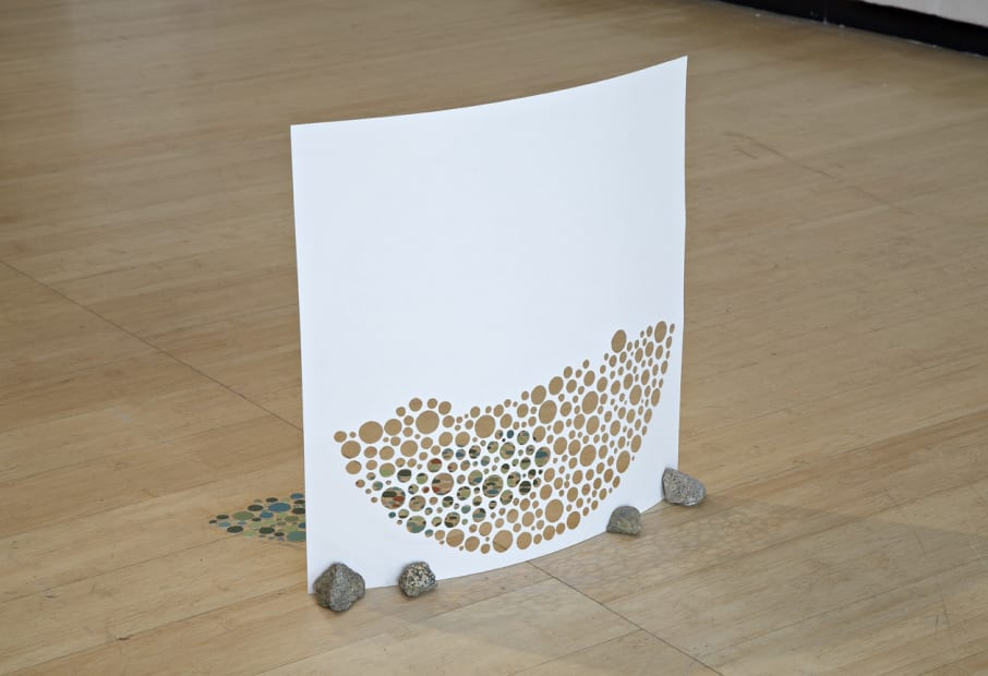 image of a paper sculpture on the floor