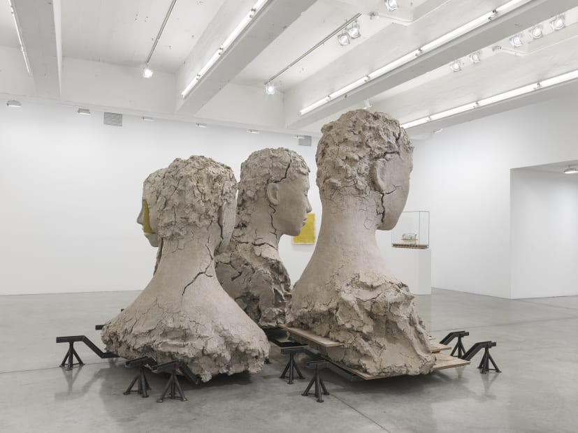 Manders large sculpture installation of four heads