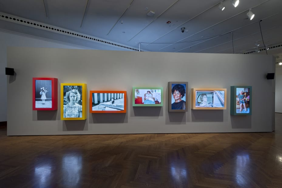 Image of Wearing installation, moving photographs in a row