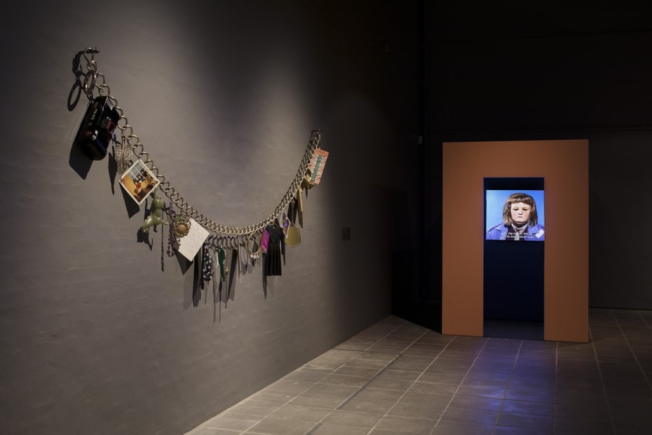 image of Gillian Wearing sculpture - enlarged necklace on wall