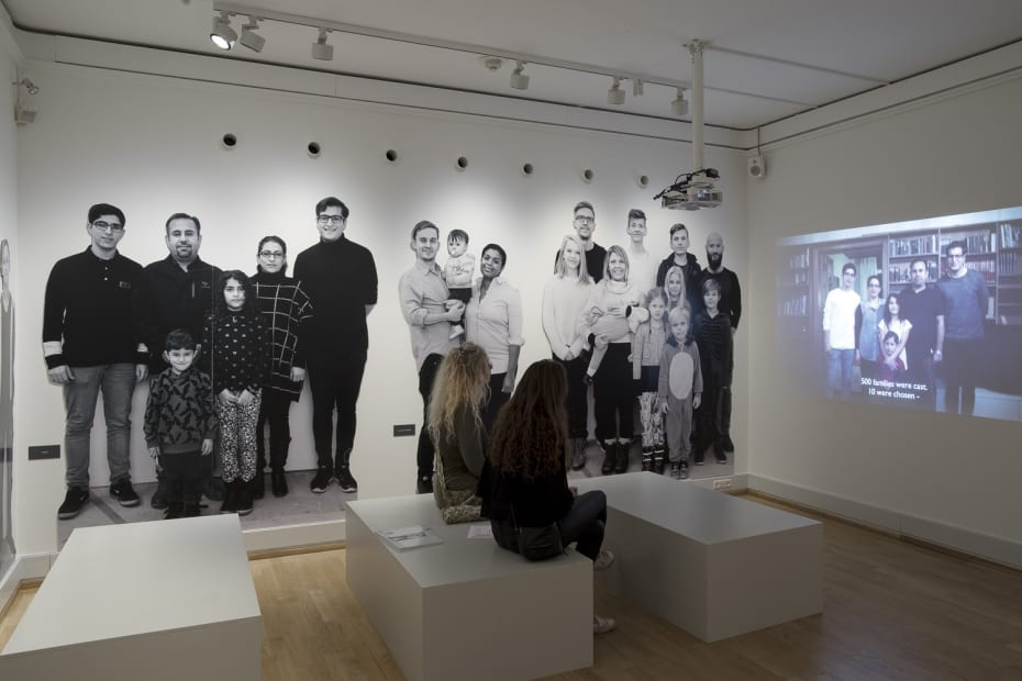 Image of Wearing video installation, still image with wallpaper of people
