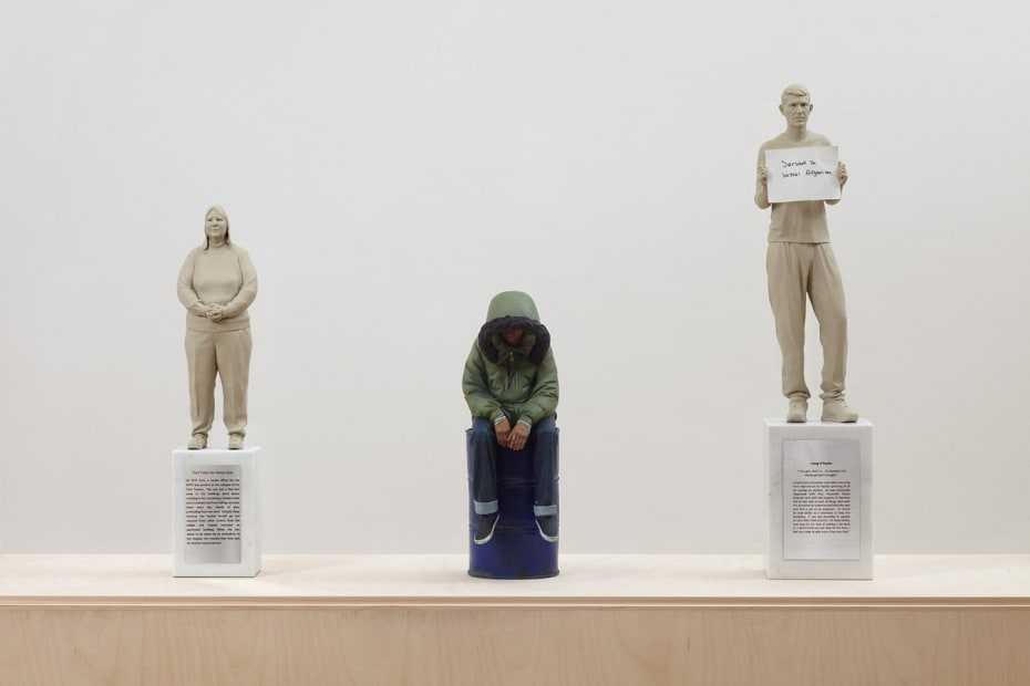 Installation view of Gillian Wearing at Whitechapel Gallery, London, sculpture of three people