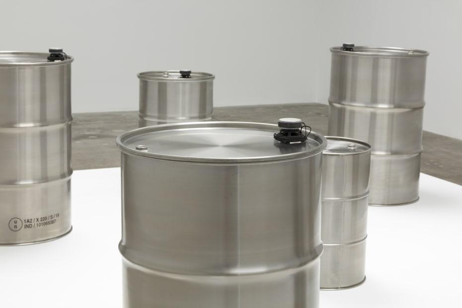 image of steel barrels on white pedestal