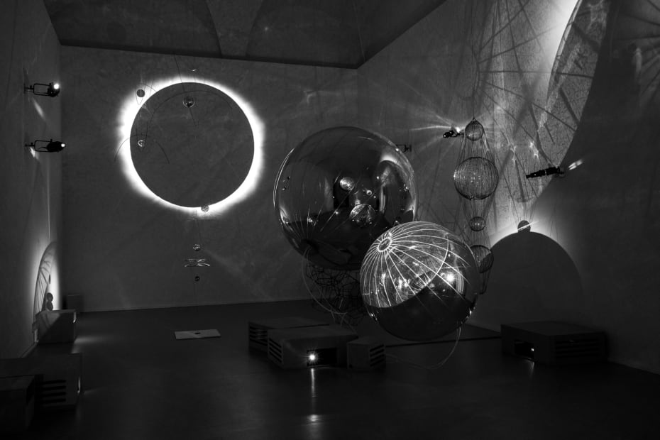 image of sculptures in dark room with shadows