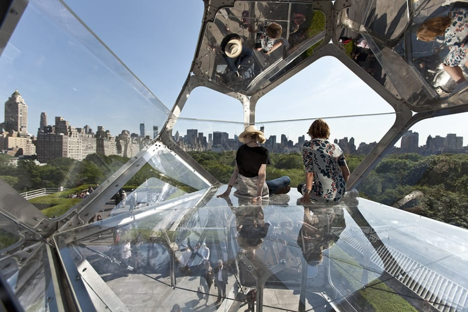 image of cloud cities installation on the Met rooftop, with people interacting with it