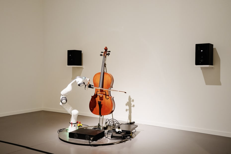 image of cello being played by a robot