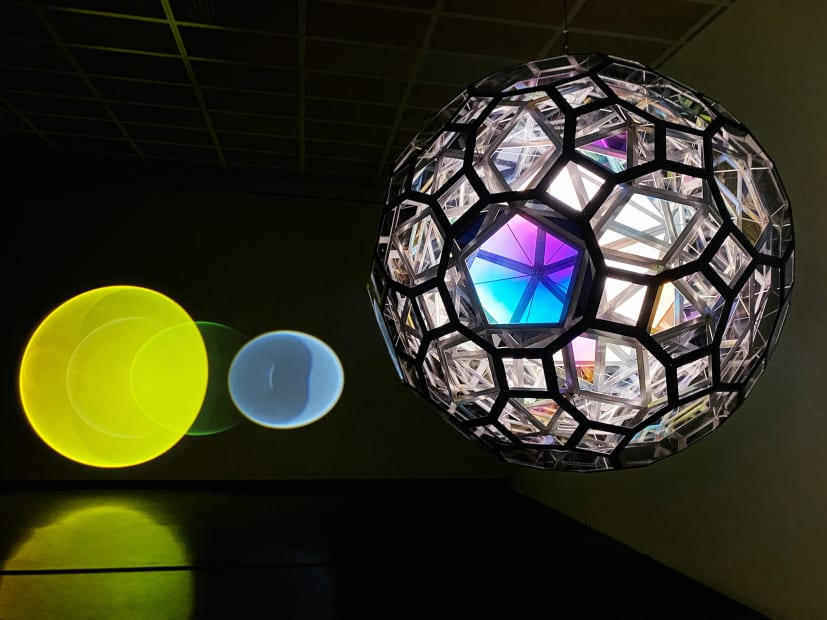image of large hanging sphere and lights