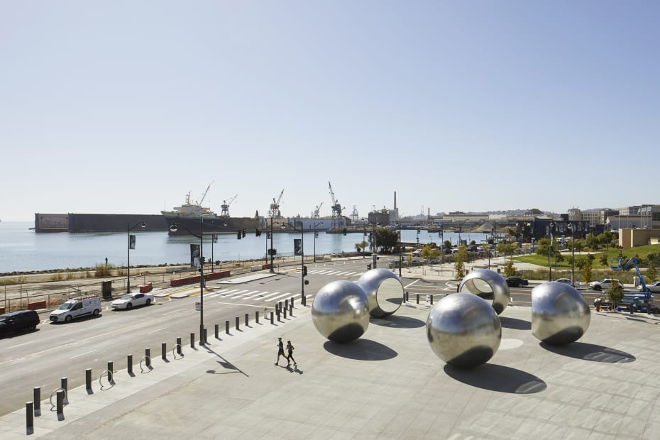 image of 5 large steel spheres with truncated mirror