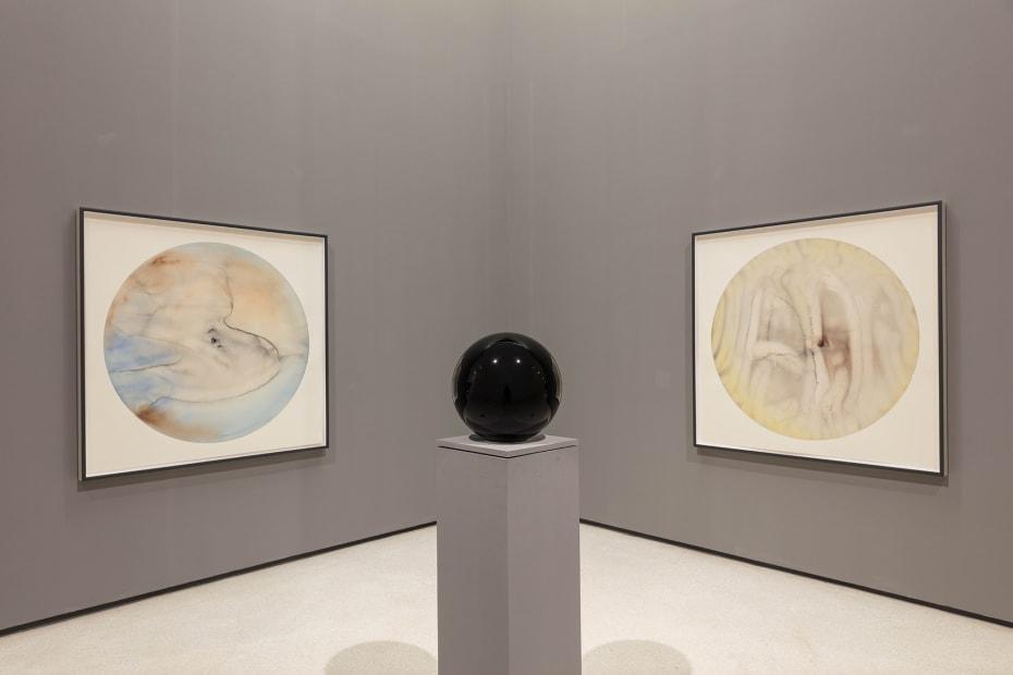 image of circular watercolors and circular crystal sphere