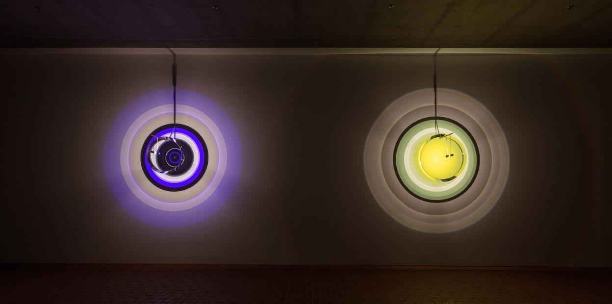 image of lighthouse lense sculptures emitting colorful lights
