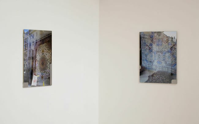 image of photographs installed on a wall