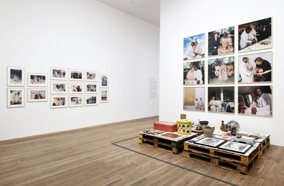 installation image of Meschac Gaba works at Tate, photographs on the wall