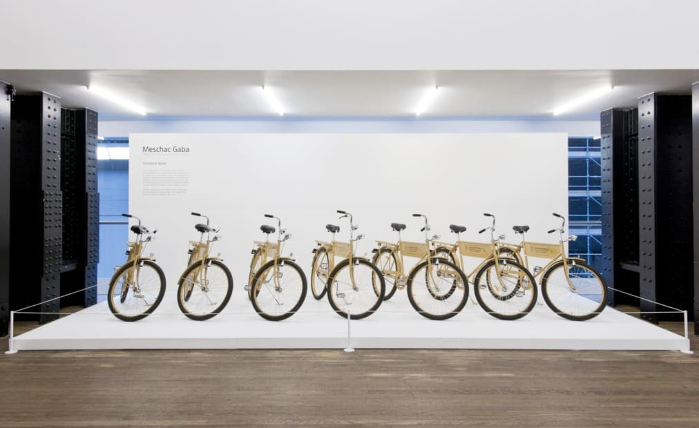 installation image of Meschac Gaba works at Tate, bikes in a line
