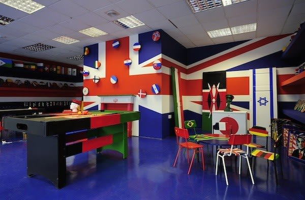 image of room covered in different flags painted on everything