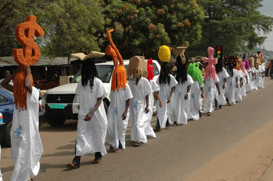 image of processional with people wearing large wigs