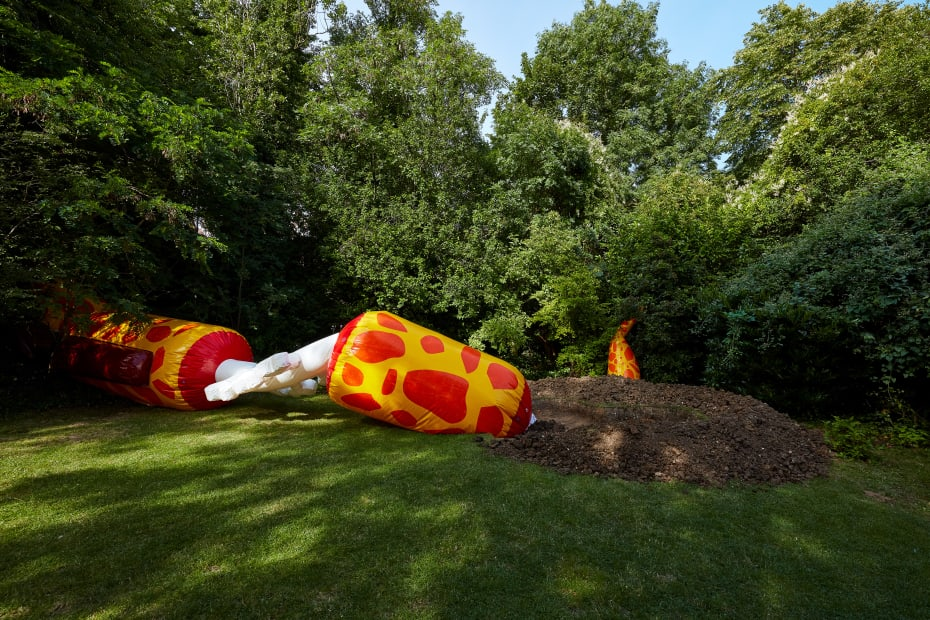 installation view of Wong Ping blow up giraffe