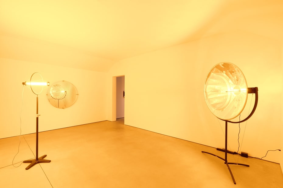 image of yellow room with two sculptures