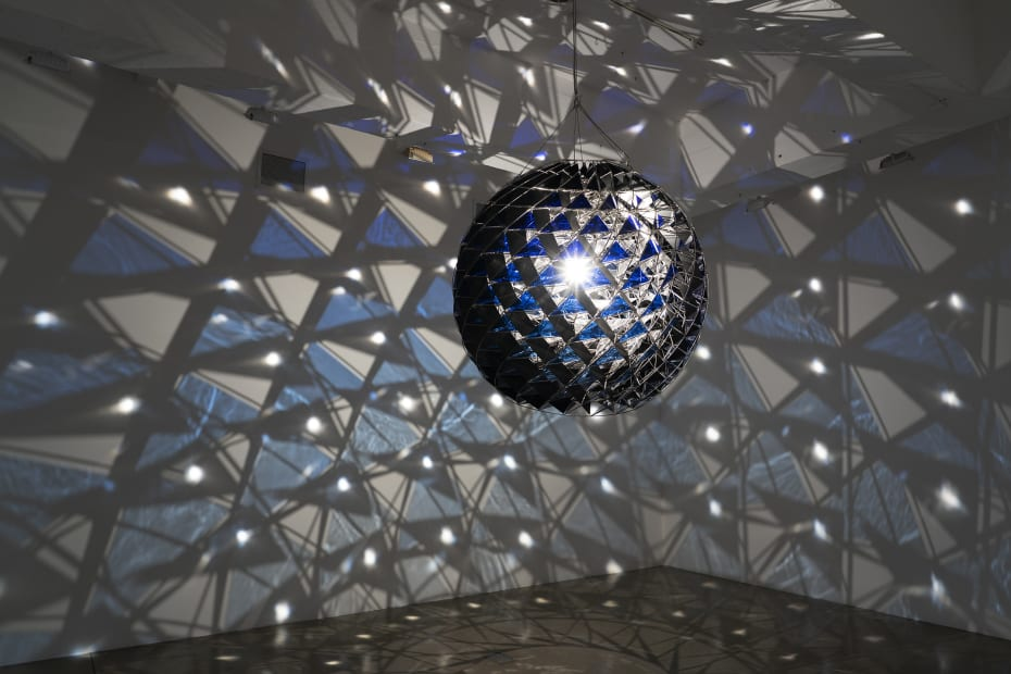 image of group show installation view, eliasson light sculpture