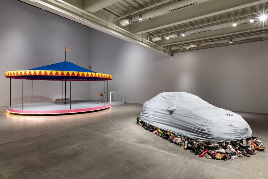 image of Karyn Olivier carosel and car cover sculptures