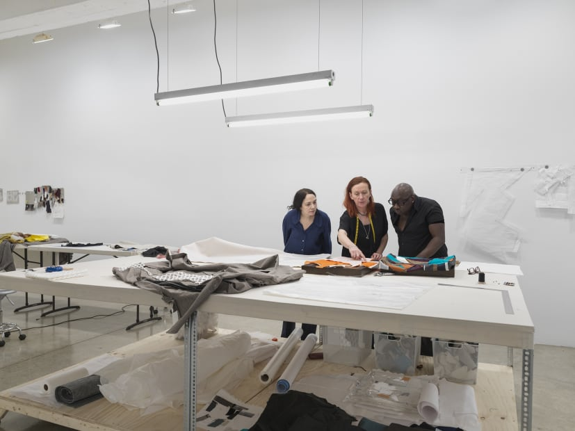 Laura Lima tailor shop install photo - tailors working