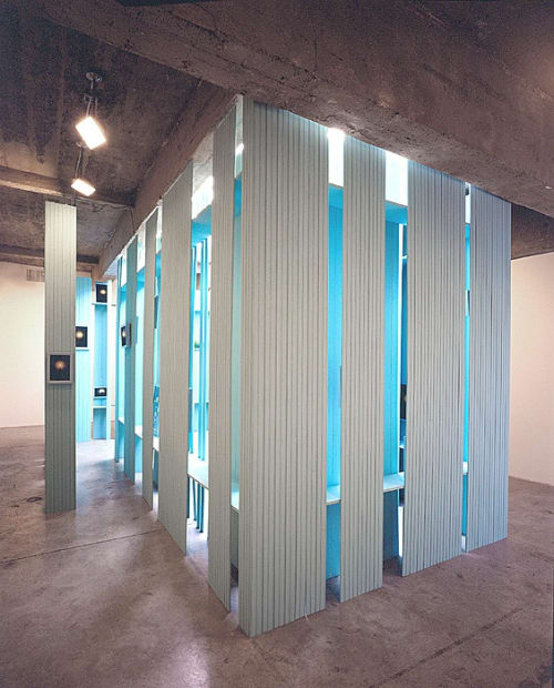Cinto blue structure under skylight with photographs