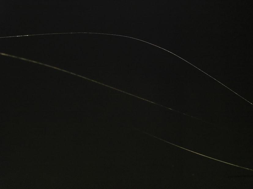 Saraceno 3 spider web threads in the dark