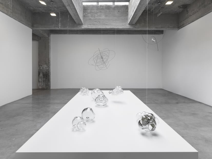 Saraceno glass objects on table and hanging sculptures