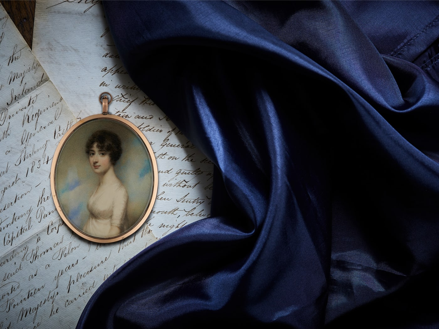 portrait miniature of Jane Austen's brother's wife displayed on hand written letters and blue fabric