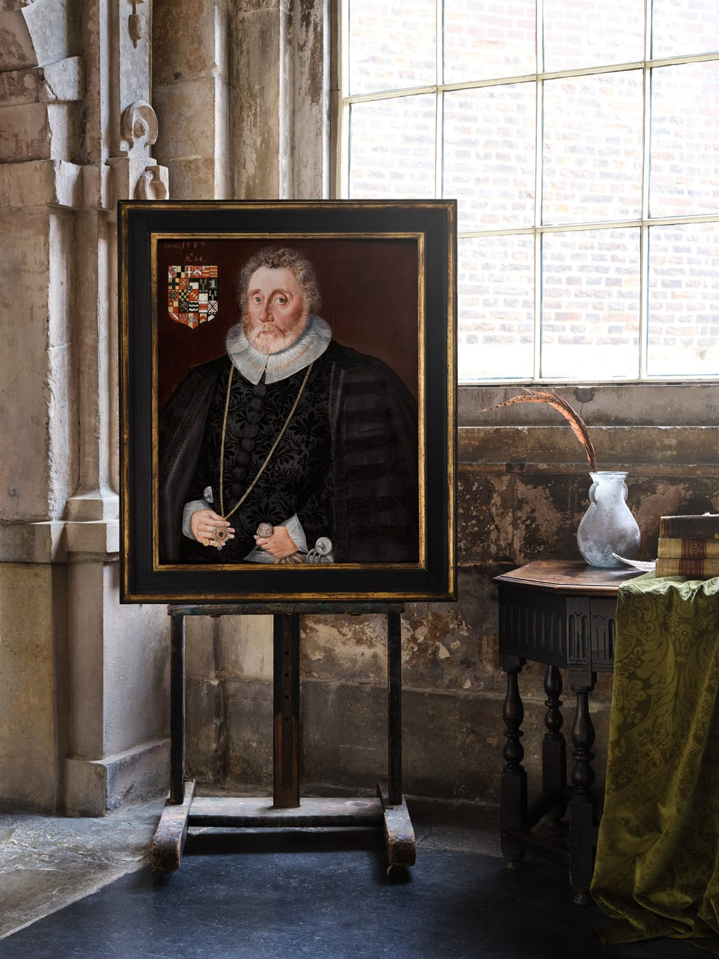 16th century tudor portrait of a gentleman on an easel in room at charter house