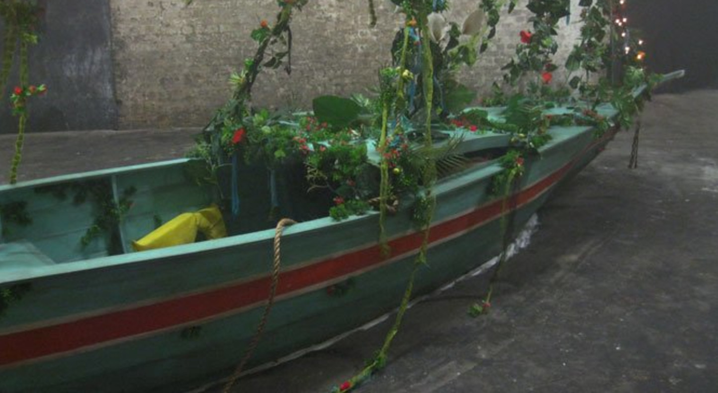 Hew Locke, Adrift, 2012, 4.7 x 5.7 x 1.2m (approx), wood, metal, artificial foliage, fairy-lights, fabric, boats