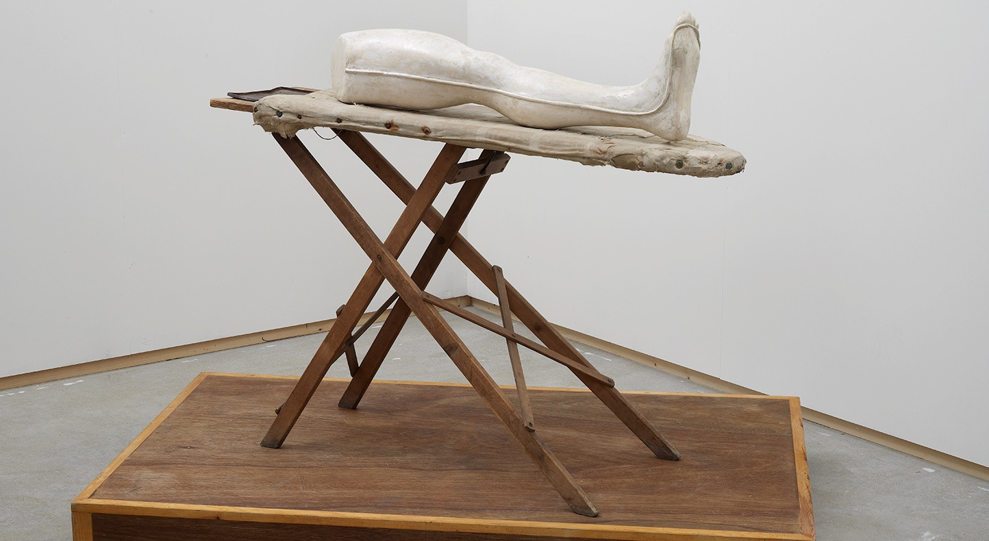 Stuart Brisley, Louise Bourgeois' Leg, 2002, Performance Object, plaster, ironing board, wood. Image courtesy of the Artist and Hales London New York. Courtesy of the Artist. Photograph by Andy Keate.