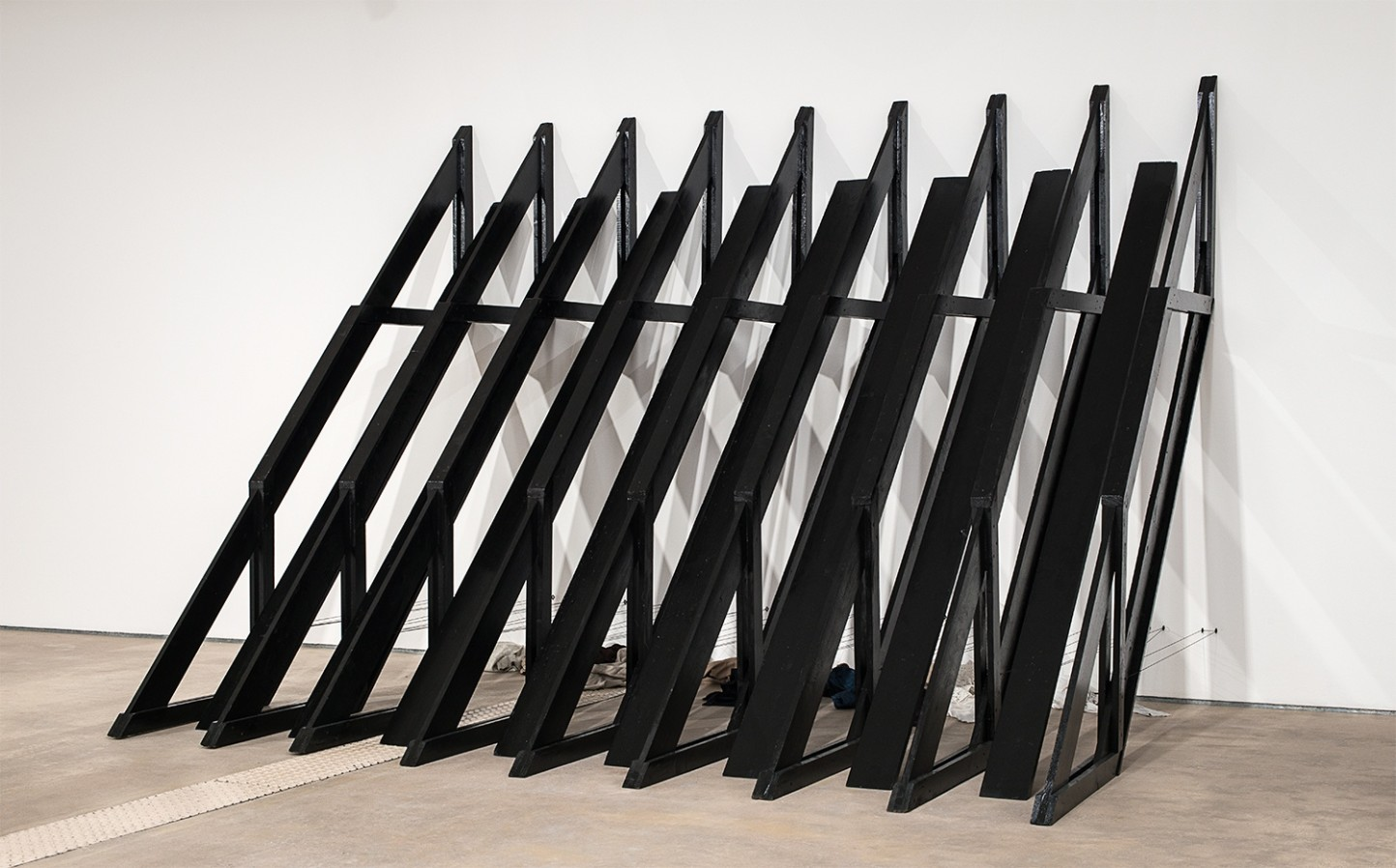 Stuart Brisley, Against the Wall, 1985-6, wooden buttresses and clothes, 233.5 x 327 x 233.5 cm, 91 7/8 x 128 3/4 x 91 7/8 in