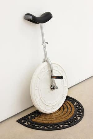 Richard Slee, Unicycle, 2012, plaster, unicycle parts, doormat, wood, 103 x 74 x 44.5 cm