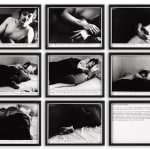 8 framed black and white images of a man sleeping in a bed and a framed text panel, organized in three rows of three