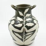 Hilda Palafox black vase sculpture with white women holding white leaves