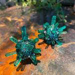 A pair of emerald and diamond 'Supernova' earrings