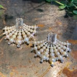 A pair of step-cut diamond and natural pearl earrings