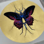 Purple, black & blue electric butterfly on gold leaf background circular background