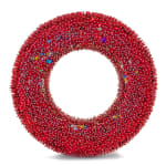 """A foam """"O"""" shape densely covered in red and gold sequins and red beads."""