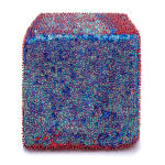 One face of a foam cube densely covered in blue and silver sequins and red and blue beads.